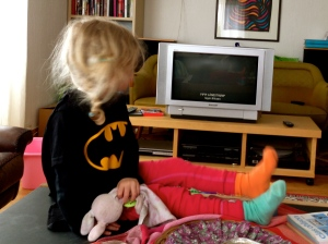With Batman's cape, Pippi's socks and her bunny and dummy safely clasped in her hands, she is ready for whatever the world throws at her